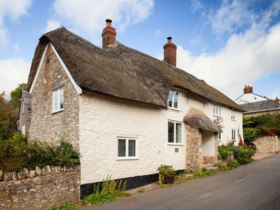 Photo for A stunning, one bedroomed, beamed thatched cottage in the village of Stockland.