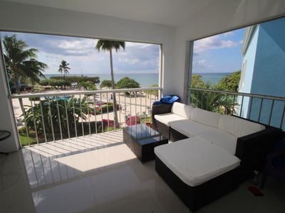 Photo for 5 Star Right on 7 Mile Beach 2BR modern & luxurious PH condo! Renovated.