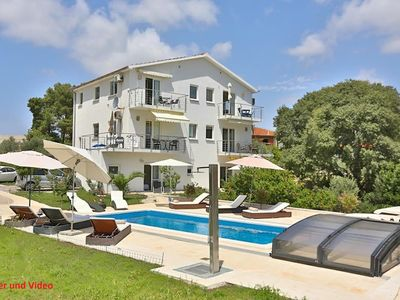 Photo for Luxury villa with private heated pool and sea view