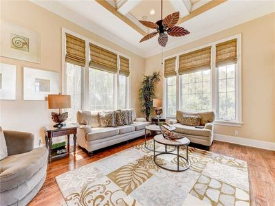 Light, Bright Elegance – From the Morning Glory living room windows you can look out on the golf course and a lake. With its elegant, yet comfortable furniture, the view indoors is just as stunning.