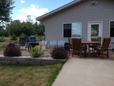 Plenty of seating on the patio that looks out to the lake.