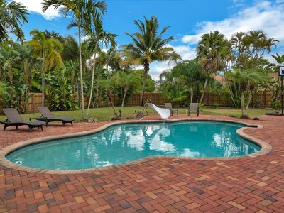 Photo for Palm Trees & Paradise! 3BR, 2BA home with huge backyard and saltwater pool!