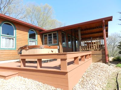 Enjoy our new deck with hot tub- drained and cleaned for each renter.