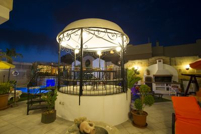 Gazebo, with Pool and Chill Out Area in Background, and Deck Area on right