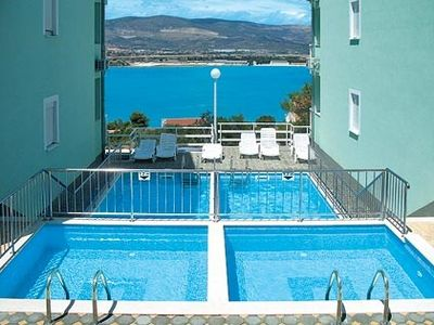 Photo for Holiday apartment with pool and sea view