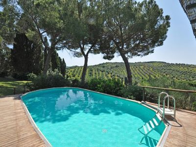 Photo for Lovely apartment for 4 guests with pool, WIFI, TV, pets allowed, panoramic view and parking