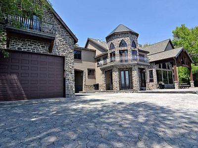 Photo for NEW LISTING! One-of-a-kind beachfront castle right on the lake w/private hot tub