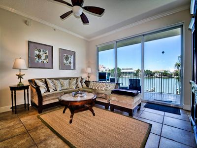 Spacious living room has access to the balcony.