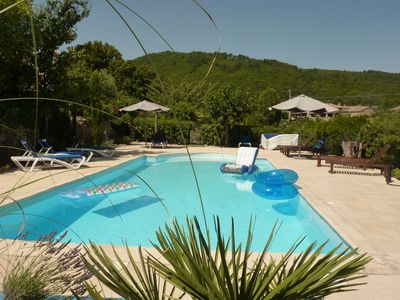 Photo for 3 cottages around a swimming pool in a small village.
