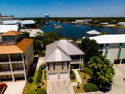 Photo for Boater's Paradise in Orange Beach! 4 BR House with Boat Slip, Community Pool, Easy Beach Access!!