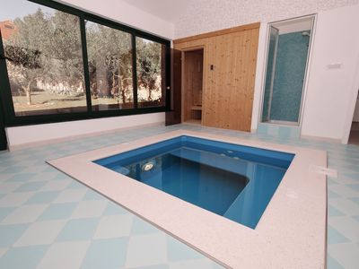 Photo for Charming apartment directly on the sea, Whirlpool and sauna, beautiful garden