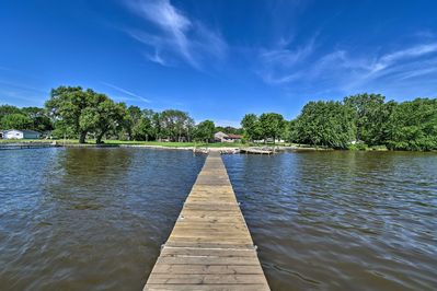 The amazing property hosts a long dock - perfect for fishing.