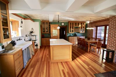 Large center Island kitchen with large farm sink