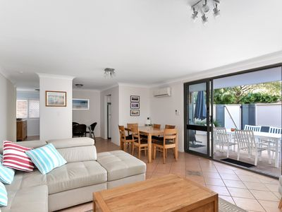 Photo for Spacious, pet friendly and flat walk to beach!