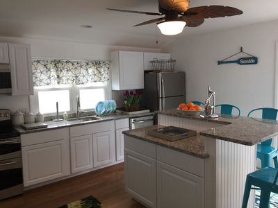 Photo for Paddle Board! 1 Block to Beach! 4 Bedroom 2 Bath 3 Decks 4 Parking Spaces!