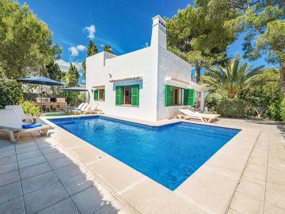 Photo for 5 bedroom Villa w/pool, free Wi-Fi & a/c, a short walk from the beach