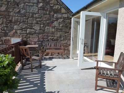 French doors leading onto the shared enclosed patio area
