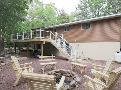 Back yard view of deck and fire pit