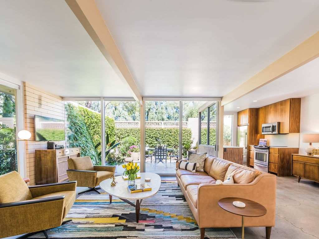 Beautifully restored mid century modern condo with mountain and pool views
