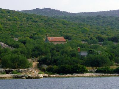Photo for Holiday house with garden by the sea, on the Croatian island of Pasman