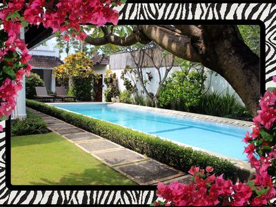 Sparkling 12 mtre 'Lap' pool. Manicured tropical gardens. Sun deck and sun beds