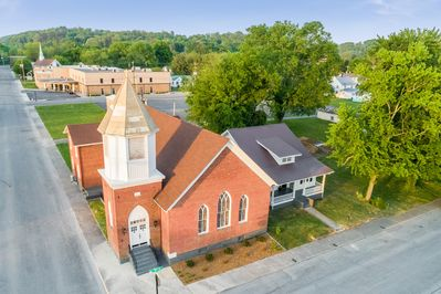 An aerial photo of the Chapel & Trinity Cottage on First Ave.