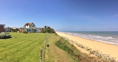 Photo for Contemporary seaside holiday chalet overlookng sandy beach, stunning sea views!!
