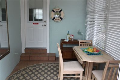 Dining room. New sliding screened windows. Oak dining set. All weather dining!