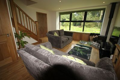 There are views from the sitting room into the woodlands