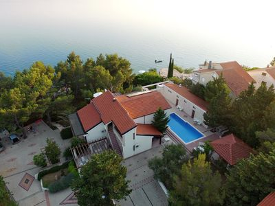 Photo for Fantastic holiday home with amazing garden, private pool, directly on the beach!