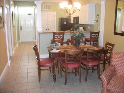 Foyer entrance,dining area, kitchen with bar and closet with new washer/dryer