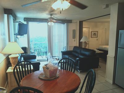 Living Room w/Leather Sofa and Love Seat, Screen Porch with table and chairs
