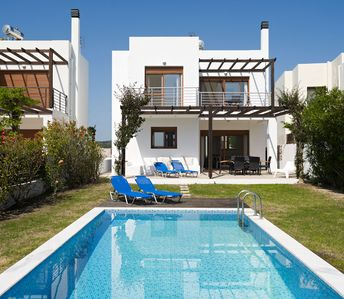 Luxury 3 bedroom villa Nisso with private pool and sea views. Pool and garden