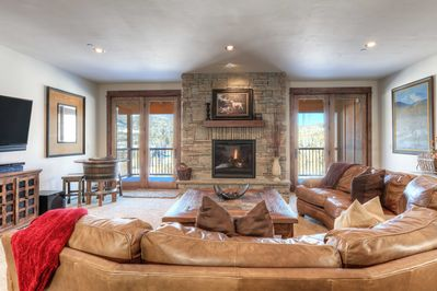 Large gas fireplace & access to the covered deck