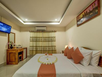 Photo for Family Suite: 1double bed & single bed - free pick up