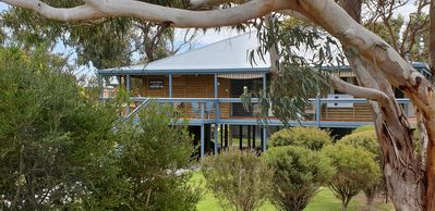 Beach House-5 minutes to beach, with deck surrounding house, family friendly