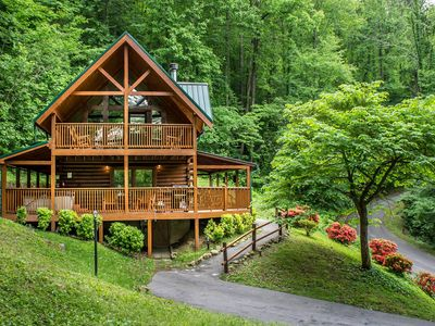 Photo for Unique cabin with wrap-around deck, hot tub, pool access and game room