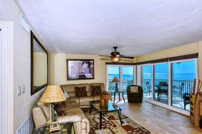 Large living room combined with sliders out to Lanai - spectacular views of world famous Crescent Beach and the Gulf of Mexico.  Large flat panel HDTV, leather sectional...