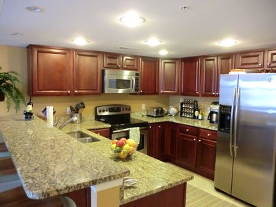 Kitchen open to combined dining room and living room.