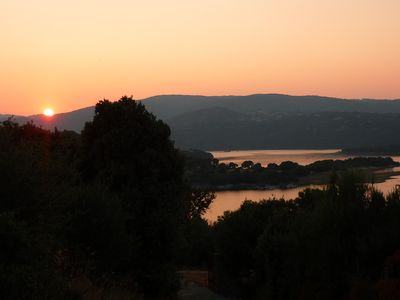 Sunset view over the lake from the property. This property screams romance.