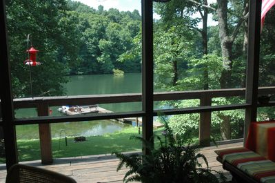 View of lake from screened in porch.