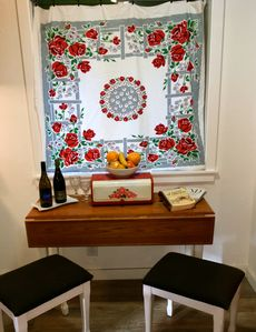 Dining nook in the kitchen comes with a bottle of Oregon wine & local cookbooks.