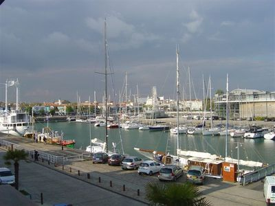 Photo for Apartment 41 m2, with GARAGE, harbor view, aquarium area, near train station.