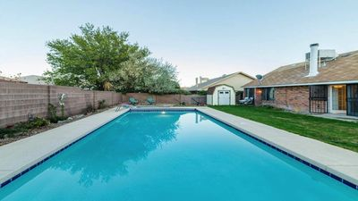 Full lap salt pool on lush sunny back yard, grill and backyard with room to roam