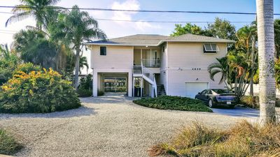 Incredible amenities featuring a screened in heated swimming pool, boat dock