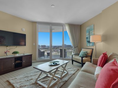Photo for 11th floor condo w/ water and pool views, private balcony, shared amenities!
