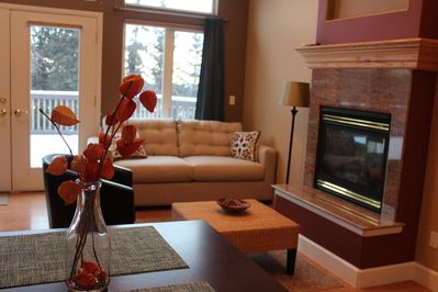 Living space includes double-sided fireplace and queen sleeper sofa.