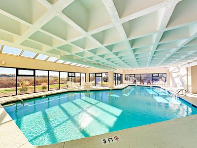 Pool - The large glass-enclosed pool is perfect for swimming and lounging.