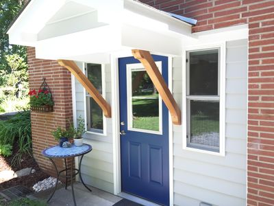 The Blue Door has a private entrance with driveway parking.