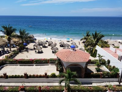 Unobstructed view from the balcony to the beach and condo's private palapas